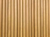 Round wooden sticks. Background. Wall Pattern. Close-up detail of round wooden sticks wall pattern royalty free stock photography