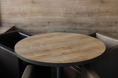 Round wooden table in a cafe Royalty Free Stock Images