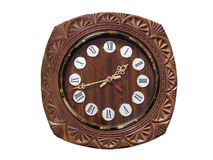 Round wooden wall clock. With carving. White background Stock Image