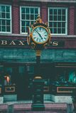 Round Yellow and Black Analog Pedestal Clock Displaying 4:58 Royalty Free Stock Images