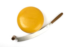Round yellow cheese with knife Stock Photos