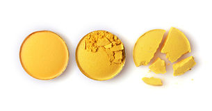 Round yellow crashed eyeshadow for make up as sample of cosmetic product Stock Images