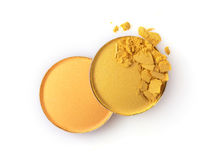 Round yellow crashed eyeshadow for makeup as sample of cosmetic product Royalty Free Stock Images
