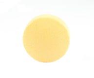 Round yellow pill Stock Image