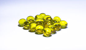 Round yellow pills Royalty Free Stock Images