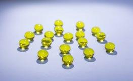 Round yellow pills Stock Photos
