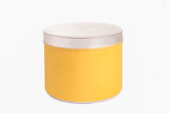 Round yellow plastic container with silver cap Royalty Free Stock Photo