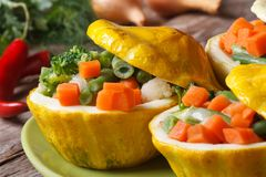 Round yellow squash stuffed with vegetables horizontal Royalty Free Stock Photos