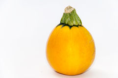 Round yellow zucchini over white Royalty Free Stock Images