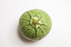 Round Zucchini-Courgette. Isolated on white, studio shot Royalty Free Stock Images