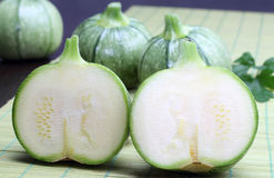 Round zucchini on a green bamboo tablecloth Royalty Free Stock Photography