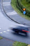 Roundabout. Picture of roundabout with blurred moving car and traffic sign in Reykjavik, Iceland Royalty Free Stock Image