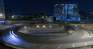 Roundabout above highway.Time Lapse. Roundabout above highway.Night scene urban traffic, of Barcelona.Time Lapse - Trail effect - Long exposure - Fixed plane stock video