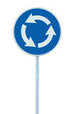 Roundabout crossroad road traffic sign isolated blue, white arrows, right hand traffic, large detailed closeup Royalty Free Stock Photography
