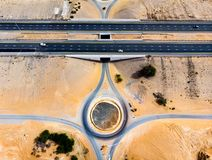 Roundabout and the desert road aerial view. Roundabout and road in the desert aerial view royalty free stock images