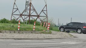 Roundabout detail. With car and electric pillar on the background Royalty Free Stock Images