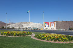 Roundabout in Fujairah, UAE. Roundabout in Fujairah with national flag and portraits of the rulers. December 14, 2014 in Fujairah, UAE royalty free stock photo