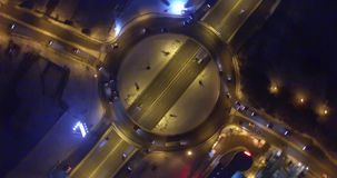 Roundabout and highway at night stock video