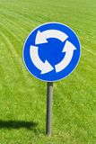 Roundabout road sign. In front of freshly mown lawn area Stock Images