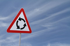 Roundabout Sign. On a blue sky background Royalty Free Stock Image