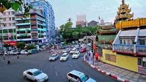 Roundabout at Sule Pagoda, Yangon, Myanmar. YANGON, MYANMAR - FEBRUARY 14, 2018: The traffic on the roundabout at the old Sule Pagoda, one of the notable stock video