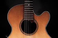 Roundback acoustic guitar with rosette purfling and extended fin stock images