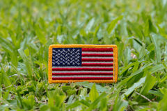 Rounded American flag patch. On on green grass field Stock Image