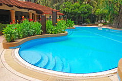 Rounded Blue Pool of a Condominium. Rounded Blue Pool with Greens of a Condominium Property in Kuala Lumpur stock photography