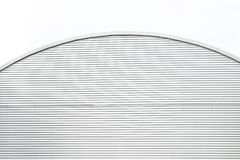 A rounded building made from metal. Top part of a metallic building royalty free stock images