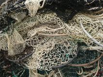 Rounded fishing net texture. In white, brown, black, green colors stock image