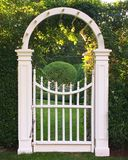 Rounded Garden Gate. A half circle gate leads to a bountiful garden on a summer`s day Stock Photography