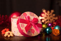 Rounded Gift Box Christmas. With ornaments Stock Photography