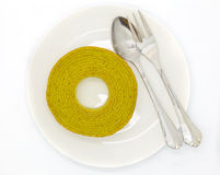 Rounded green tea layers cake on white dish Stock Images