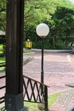 Rounded lamp post at local park royalty free stock image