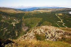 Rounded mountain peak with pathway from Snezka, Czech republic. Royalty Free Stock Photography