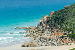 Rounded red rocks in Wilsons Promontory - Squeaky Beach.  Stock Images
