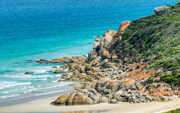 Rounded red rocks in Wilsons Promontory - Squeaky Beach.  Stock Photography