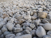 Rounded rocks. Rounded rocks on coast and beach area. Asturias. Spain Stock Photo