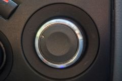 Rounded selector switch in the car. Black selector with chrome edging Stock Photo
