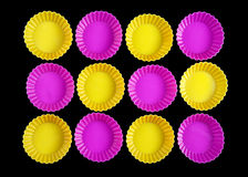 Rounded shape background. Group of yellow and pink rounded objects rotated on black background stock images