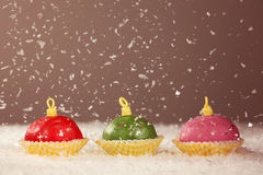 Rounded small cakes with snow. Delicious Rounded small cakes with snow Stock Photo