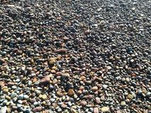 Rounded stones. Stones with rounded edges by the action of the water of the Mediterranean Sea on the beach of Puerto de Sagunto stock image
