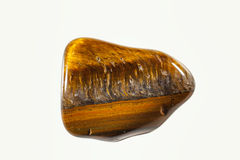 Rounded tiger eye crystal stone Stock Photography