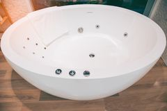 Rounded white bathtub in modern bathroom. royalty free stock photos