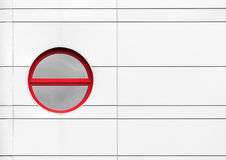 Rounded window as abstract architecture detail. Abstract architecture detail with rounded red window on metal building wall royalty free stock image