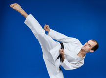 Roundhouse kick making the athlete Royalty Free Stock Images