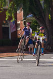 Rounding the Corner. Riders compete in the 2015 Frederick, Maryland Clustered Spires High Wheel Race, the only high wheel race of its kind in America royalty free stock photos