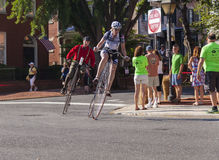 Rounding the Corner. Riders compete in the 2015 Frederick, Maryland Clustered Spires High Wheel Race, the only high wheel race of its kind in America stock image