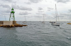 Rounding The point - Sailing Boats Harbour Entrance Royalty Free Stock Image