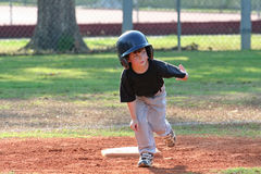 Rounding second base. Young t-ball player rounding second base Royalty Free Stock Images
